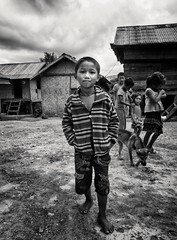 Tribal village near Hoi An (rosemarysedgwick) Tags: vietnam hoian monochrome village travel portrait tribal boy childrenplaying