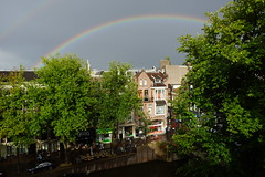 Rainbow Over Masterdam (steve_whitmarsh) Tags: amsterdam netherlands holland city urban building architecture rainbow trees topic