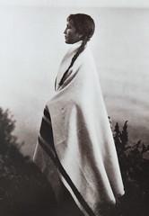 """Every Wind, Ojibiwa"" (Chippewa).  Photograph by Roland Reed (ca. 1915) (lhboudreau) Tags: nativeamericans nativeamerican americanindian americanindians portrait vintagephoto vintagephotograph sepia sepiatoned print vintagephotography rolandreed everywind ojibwa chippewa 1915 postcard postcards vintagepostcard vintagepostcards azusa azusapublshing azusapublishinginc 1991 postcard178 blackhair braid braids braided hair indiansquaw squaw profile monochrome blackandwhite blackwhite rolandwreed pictorialist focus lighting blanket indianblanket"
