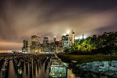 Lower Manhattan (HisPhotographs.com) Tags: newyork new york newyorkcity brooklyn nyc ny skyline night clouds longexposure lower manhattan buildings lights skyscraper brooklynbridgepark east river dimond reef graffiti