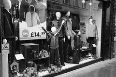 The Kid said my hand are up. I still took the shot... (WorcesterBarry) Tags: blackwhite bnw blackandwhite places photographers candid england city humour happiness lovebw love monochrome outdoors urban fun travel tourists reflection retail worcester advertisement display