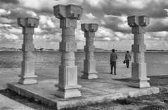 Framed by the Pillars (Bhuvan N) Tags: mysore mysuru krsbackwaters travel water clouds architecture india karnataka blackandwhite monochrome people sony xperia evening framing pillars sky river friends
