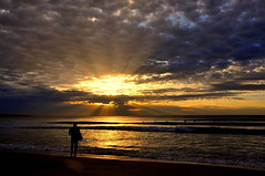 Surfer at Sunrise (missgeok) Tags: sunrise cronullabeach cronulla sydney newsouthwales australia cloudy skycapture goodmorning day outdoor spring raysofsunshine silhouettes darkness lighting composition