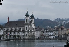 Beautiful Lucerne, taken from Chapel Bridge. (natureflower) Tags: lucerne switzerland lake architecture swans bridge