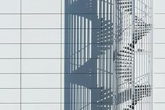 Shadowplay with a white spiral staircase (Jan van der Wolf) Tags: map190159ve monochrome monochroom spiralstaircase wenteltrap shadowplay schaduwspel lines interplayoflines playoflines lijnen lijnenspel white wit shadows schaduwen