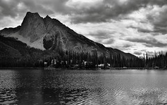 Mount Burgess as a Magnificent Backdrop for Emerald Lake (Black & White, Yoho National Park) (thor_mark ) Tags: nikond800e day3 triptoalbertaandbritishcolumbia mountburgess aroundemeraldlake emeraldlake silverefexpro2 blackwhite capturenx2edited colorefexpro yohonationalpark outside nature landscape overcast rockymountains canadianrockies mountains mountainsindistance mountainsoffindistance hillsides hillsideoftrees evergreens trees emeraldlakeroadarea alongemeraldlakeroad walkingaroundemeraldlake lake centralmainranges waputikmountains presidentrange portfolio project365 emeraldlakelodge lodge mountainside britishcolumbia canada