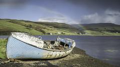 Loch Harport Rainbow (grahamhutton) Tags: rainbow lochharport carbost merkadale satran b8009 drynoch glendrynochlodge a863 isleofskye skye scottishhighlands scottishhighlandsandislands scotland sonya7 sony35mmf28za boat rott rotting broken colours rain water braighcoillenadroighniche