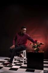 Elegance (andreea_muntean) Tags: man blackman flowers vase redlight studio people studiolight indoor photographer photography andreeamuntean waterloo