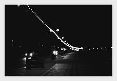 Blured Night life B/W (Zonit) Tags: bw blackandwhite sepia nightphotography nightlife illuminations lights nightshot nikon nikond700 landscape framed aesthetic lighting lighttrails bokeh blur defocused scene 50mmf18 dark cleethorpes seafront promenade