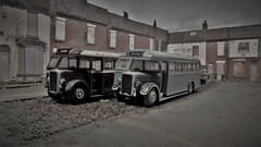 Yorkshire Woollen Buses Parked on a Bomb Damaged Terrace. (ManOfYorkshire) Tags: leyland ts8 halfcab bet style buses yorkshire yorkshirewoollen bombsite desbury terraced blitz demolition demolished terrace houses wartime grey livery efe scale diecast bus model models 176 oogauge