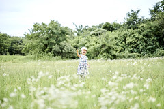 HAPPY IN THE MIDDLE OF NOWHERE (PHOTOGRAPHYSUAT) Tags: daughter green field flower grass bright light happy children child kid smile happiness nikon outdoor nature poppy flicker explore mostviewed numberone number1