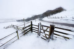 Gate to Mam Tor (Julian Barker) Tags: mam tor edale peak district dark derbyshire hill road sweep trees gate fence composition cold snow low temperature winter freezing white julian barker canon dslr 600d simple simplify blanket england uk seasons europe weather event