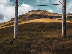 Danger of Death - Argyll Sept 2018 (GOR44Photographic@Gmail.com) Tags: power lines hill gor44 scotland argyll butterbridge ardlui arrocharalps panasonic g9 olympus 1240mmf28 grass cloud