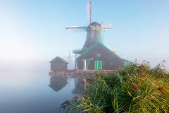 Giants of the past. (rudi.verschoren) Tags: mill fog mist nature water sky green grass canon colors contrast low old heritage holland landscape light lines mood museum outdoor overlooking pittoresque infrastructure autumn authentic