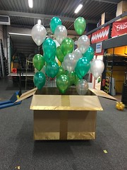 Gift box with green balloons