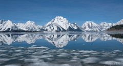 Double Vision (laura's Point of View) Tags: reflection lakejackson grandtetonnationalpark gtnp nationalpark lake waterscape landscape mountain mountains water ice snow cold spring blue nature may beauty beautiful jacksonhole wyoming unitedstates northamerica sky outdoors lauraspov lauraspointofview