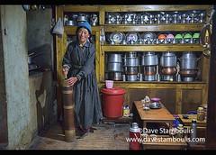Old woman making Tibetan butter tea, Lamayuru, Ladakh, India (jitenshaman) Tags: travel worldtravel destination destinations asia asian india indian ladakh ladakhi lamayuru tibetan tibetans old elderly ritual rite tradition traditional culture cultural buttertea tibetanbuttertea tibetantea churn butterchurn mix kitchen cook prepare drink wrinkled woman oldwoman tsampa churns butter fresh