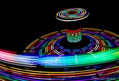 Color Circle (Maureen Medina) Tags: maureenmedina artizenimages ride carnival fair tiltowhirl color rainbow lights nighttime night circles chapes abstract vibrant onblack motion slow shutter soeed lines