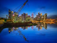 City overhaul (Rexer Ong) Tags: city water skyline building sky tree river skyscraper bridge crane