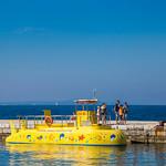 Yellow submarine with people on pier in Zadar, Croatia thumbnail