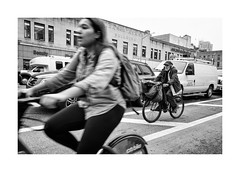 City cycling (Paphylo) Tags: instagram leicaq monochrome street people manhattan movement blackandwhite city newyork document bycicle