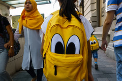 Hong Kong (jaumescar) Tags: street urban yellow eyes kids juxtaposition funny color bagpack cartoon colormatch city family three people