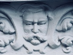 President Taft Like Gargoyle Face Above Doorway 4771 (Brechtbug) Tags: president taft like gargoyle face above doorway building facade 25th street between 7th 8th avenues nyc 11122018 new york city midtown manhattan 2018 gargoyles portraits monster portrait monsters creature faces spooky art architecture sculpture keystone mask brownstone brown stone