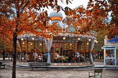 Autumn in Paris (stephaneblaisphoto) Tags: amusement park ride animal representation architecture art craft arts culture entertainment autumn building exterior built structure carousel horses change day incidental people merrygoround nature outdoors man made space plant tree paris france carrousel manège
