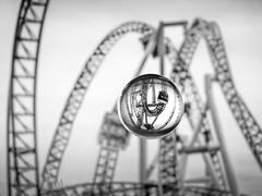roller coaster in my crystal ball (marianna_armata) Tags: p2890330 bw mono monochrome monochromatic greyscale blackandwhite rollercoaster ride glass crystal ball sphere macro mariannaarmata