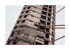 Too big to fail (Samuel Zeller) Tags: london tower building construction falling fujifilm highrise city urban decay destroyed concrete massive