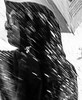 Portrait in the rain (A. Yousuf Kurniawan) Tags: portrait blackandwhite monochrome closeup rain silhouette muslim blur contrast streetphotography cameraphone cameraphonestreet decisivemoment movement rainy drizzle
