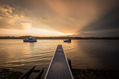 It's all about the light (WayneG58) Tags: afterthestorm seascape jetty water boats australia lakemacquarie beams reflections reflection sunsets sunset home coalpoint