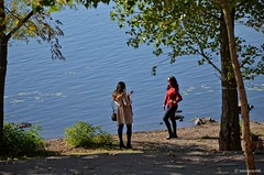 On a Warm Autumn Day (smuta2006) Tags: river riverfront creek dnieper dnipro riverbank bank beach sand ground water ripples nature tree leaves trunk stem bole rind bark snag grove copse woods forest undergrowth brushwood thicket plant grass weed bush shrub twig branch girl young woman women beauty beautiful portrait spontaneous emotional model modeling pose posing photographer mobile phone cellular camera shoot shooting smile sunglasses autumn fall landscape scenery sunlight light shadow gleam glow kyiv kiev ukraine europe affinityphoto hdr nikon d5100