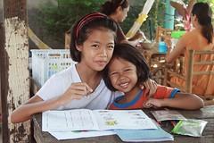 girls doing homework (the foreign photographer - ฝรั่งถ่) Tags: two girls children homework sitting khlong thanon portraits bangkhen bangkok thailand nikon d3200