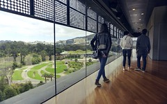 Walking above Golden Gate Park (PeterThoeny) Tags: sanfrancisco sanfranciscobay california deyoungmuseum museum tower lookoutpoint floor reflection sky cloud people indoor sony a6000 selp1650 1xp raw photomatix hdr qualityhdr qualityhdrphotography fav100