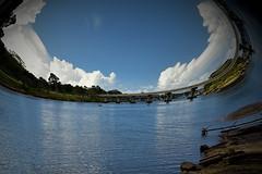 Port hole (Dreaming of the Sea) Tags: sliderssunday bluesky bundaberg burnettriver clouds manipulation bridge hss water boats gimp