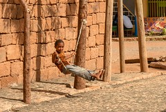 Street Swing (Rod Waddington) Tags: africa african afrique afrika äthiopien adigrat ethiopia ethiopian ethnic etiopia ethnicity ethiopie etiopian streetphotography street rope swing outdoor child girl swinging culture cultural candid