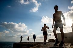 Boys on the Wall-DSC_1220 (thomschphotography3) Tags: boys teenagers israel haifa wall ocean shilouette streetphotography