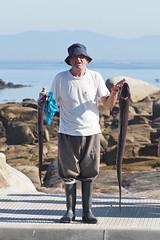M2119619 E-M1ii 87mm iso200 f5.6 1_500s 0.3 (Mel Stephens) Tags: galicia holiday o grove spain 20180911 201809 2018 q3 2x3 4x6 tall olympus mzuiko mft microfourthirds m43 40150mm pro mc14 omd em1ii ii mirrorless coast coastal people animal animals fish fisherman best