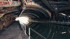 End of the tunnel (vincentag) Tags: paris france bridges architecture metallic beams underground canal water