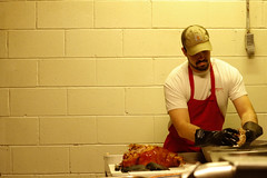 Luke Askew begins the morning by tearing the meat off the bone. He came back for a few weeks to help his family out after his father's quadruple bypass surgery, which left the restaurant short handed.