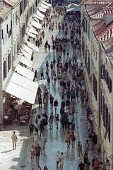 Stradun (the underlord) Tags: oldtown pedestrian street dubrovnik people nikonfe nikkorq135mmf28 film filmcamera stradum croatia dalmatia tourists kodakportra400 c41presskit