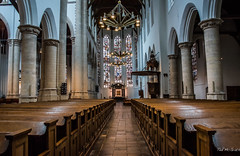2018 - Delft - Oude Kerk (Ted's photos - For Me & You) Tags: 2018 cropped delft nikon nikond750 nikonfx tedmcgrath tedsphotos vignetting oudekerk delftoudekerk oudekerkdelft delftoldchurch oldchurchdelft church churchinterior aisle seating seats seated columns emptyseats arches stainedglass