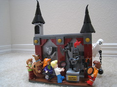 The Secret of Black Manor (jgiese626) Tags: lego moc vignette castle mansion manor stone stonework pillar curtains spire tower crest arms spear halberd statue armor ghost monster daphne velma fred shaggy scoobydoo camera axe torch