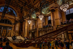 Sleeping Little Boy Giant (Niaic) Tags: liverpool stgeorgeshall littleboygiant sleeping puppet marionette royaldeluxe spectacular giant giants liverpoolsdream display show hammock rest resting crowd people watching watch view viewing hall grand grandeur loxia zeiss zeissloxia2821 sony a7ii ceiling architecture building
