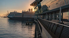 Vancouver Waterfront (Sworldguy) Tags: vancouver conventioncentre rotterdam hollandamerica cruiseship port harbour sunset sunrays glow reflections autumn water waterfront terminal canadaplace britishcolumbia sonya73 sky downtown pacificnorthwest bc