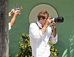 White Shirted photographer  103 (LarryJay99 ) Tags: pridefest2018 2018 lakeworth florida festival parade photographer men male man guy guys dude dudes canondslr canoncanon handsome handsomenen hairyarms streets streetstuff urbanimpressions urbannomads urbanites people gaypeople urban container script potted plant street furniture los olas ft lauderdale