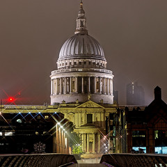 St Paul's on a cloudy night (Geoff Henson) Tags: cathedral church dome pillars statues windows lights gloomy cloudy misty sky bridge starburst building architecture london