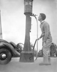 Vintage fill-up, 1940's (clarkfred33) Tags: gas gaspump vintagephoto vintage friend ford 1935ford vintageautomobile gasoline historic historicphoto leica 1940s blackandwhite restoration photorestoration