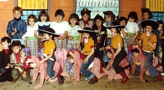 Ride um cow person (theirhistory) Tags: boy children kid girl school class form group pupils jumper trousers wellies shoes coeboy cowgirl cowthing costume rubberboots hat animal